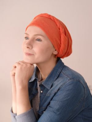 Young female cancer patient with headwrap