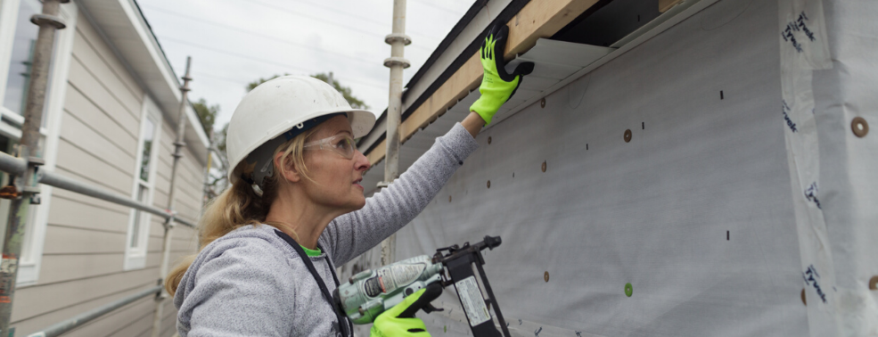 Women Builder at work on new home construction