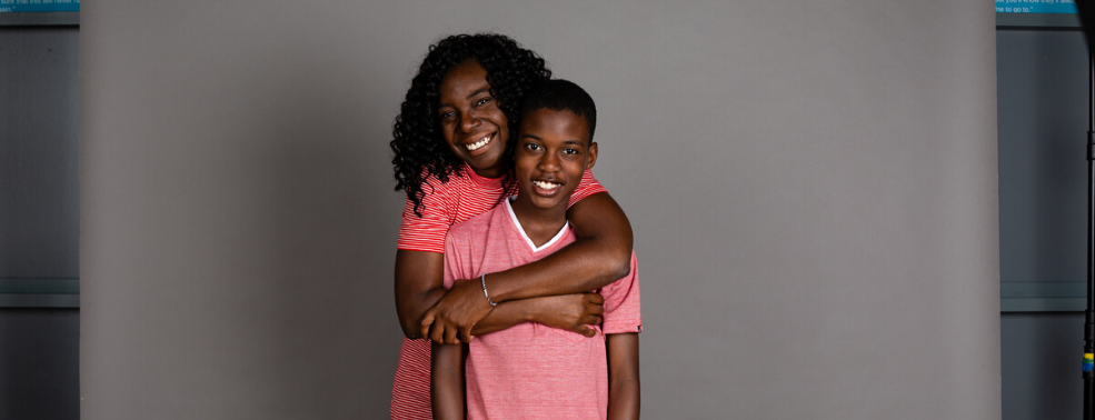 Habitat Homeowner Denae Poses with Her Son before Moving into New Home