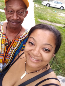 Tabitha poses for a selfie with her dad